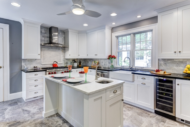 White cabinets in a kitchen are a classic look.